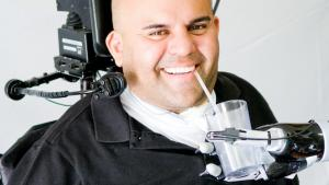 Tetraplegic Patient Controls Robot Arm With Thought